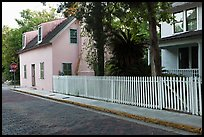 White picket fence and houses on cobblestone street. St Augustine, Florida, USA ( color)