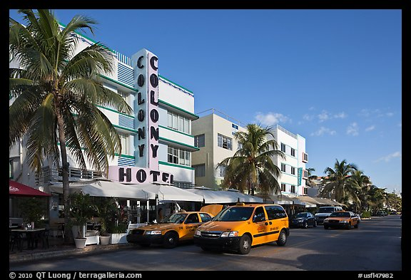 Taxi cabs and row of hotels in art deco architecture, Miami Beach. Florida, USA