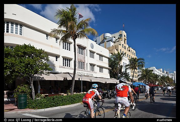 Cyclists passing Art Deco hotels, Miami Beach. Florida, USA