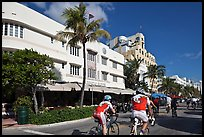 Cyclists passing Art Deco hotels, Miami Beach. Florida, USA (color)