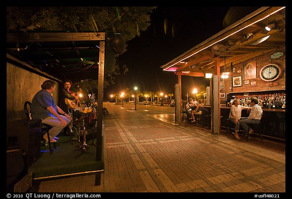 Salsa musicians and bar at night, Mallory Square. Key West, Florida, USA (color)