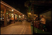 Musicians and restaurant at night, Mallory Square. Key West, Florida, USA (color)
