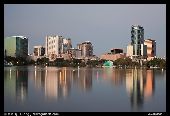 Skyline at dawn from lake Eola. Orlando, Florida, USA (color)