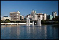 Fountains and morning skyline from Lake Lucerne. Orlando, Florida, USA (color)