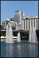 Fountains and downtown high-rises from Lake Lucerne. Orlando, Florida, USA (color)