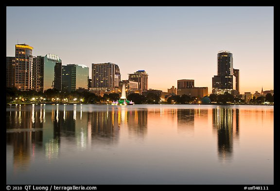 Downtown skyline at sunset, lake Eola. Orlando, Florida, USA (color)
