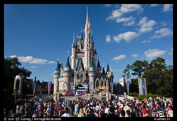Iconic Cindarella Castle with visitors gathered for show, Magic Kingdom. Orlando, Florida, USA