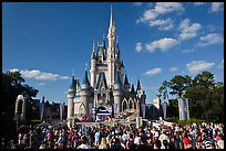 Iconic Cindarella Castle with tourists gathered for show, Magic Kingdom. Orlando, Florida, USA (color)