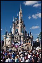 Visitors attend stage musical in front of Cindarella castle. Orlando, Florida, USA