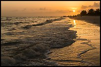 Beach with people in the distance at sunset, Sanibel Island. Florida, USA (color)