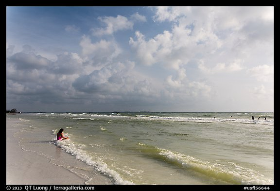Woman sitting in water, Fort De Soto beach. Florida, USA (color)