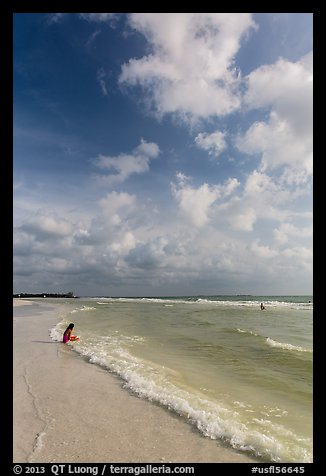 Woman and wave, Fort De Soto beach. Florida, USA (color)