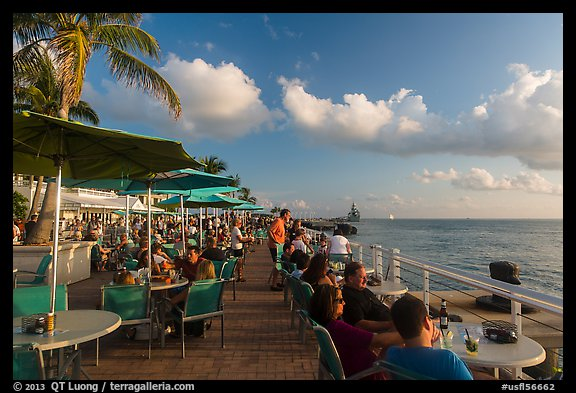 Waiting for sunset with drink in hand on Mallory Square. Key West, Florida, USA (color)