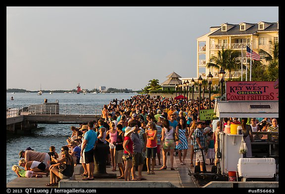 Crowd gathered for sunset in Mallory Square. Key West, Florida, USA (color)