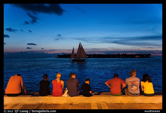 Tourists watching ocean after sunset, Mallory Square. Key West, Florida, USA (color)