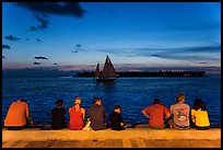 Tourists watching ocean after sunset, Mallory Square. Key West, Florida, USA ( color)