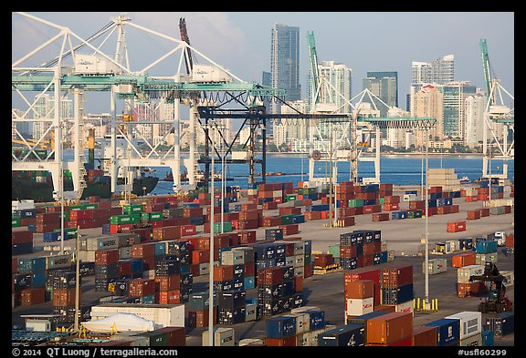 Shipping containers, cranes, and skyline. Florida, USA (color)