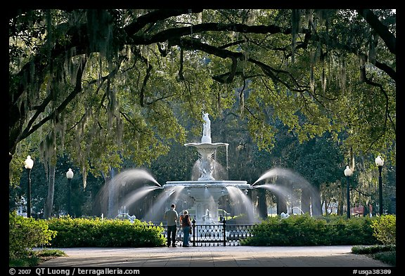 Fountain in Forsyth Park with couple standing. Savannah, Georgia, USA (color)