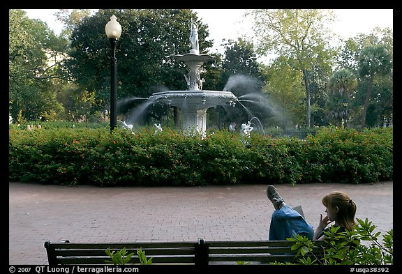 Woman reading in front of Forsyth Park Fountain. Savannah, Georgia, USA (color)