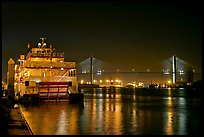 Riverboat, and Savannah Bridge at night. Savannah, Georgia, USA
