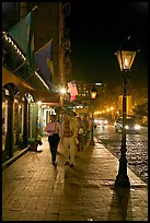 People on sidewalk of River Street by night. Savannah, Georgia, USA