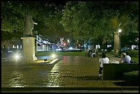 Square by night with people sitting on benches. Savannah, Georgia, USA (color)