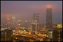 Mid-town high rise buildings in fog a dawn. Atlanta, Georgia, USA (color)