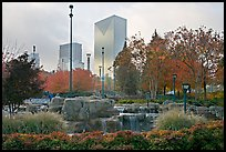 Fall colors and cascades in Centenial Olympic Park with skyline. Atlanta, Georgia, USA (color)