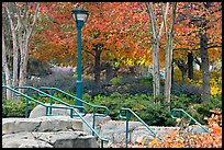 Railings, lamp, and trees in autumn colors, Centenial Olympic Park. Atlanta, Georgia, USA ( color)