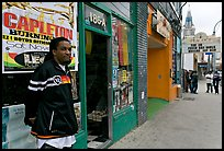 Man standing in front of music store, sweet Auburn. Atlanta, Georgia, USA (color)