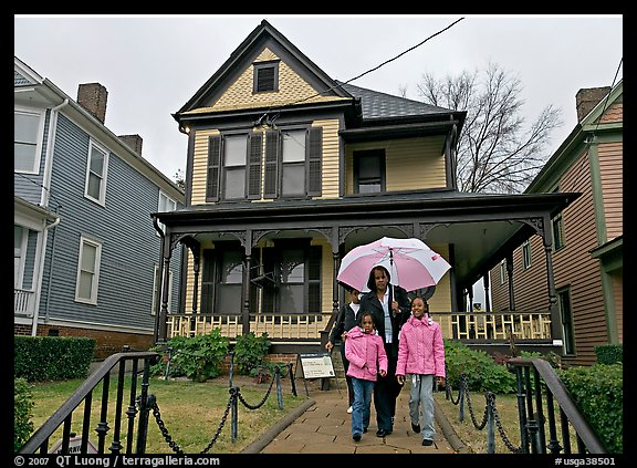 African American family with umbrella in front of Birth Home of Martin Luther King Jr. Atlanta, Georgia, USA
