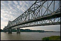 Barge on the Mississippi River approaching bridges. Natchez, Mississippi, USA (color)