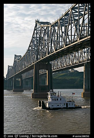 Tugboat under brige on Mississippi River. Natchez, Mississippi, USA (color)