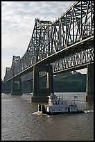 Tugboat under brige on Mississippi River. Natchez, Mississippi, USA