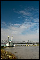Mississippi River, paddle riverboat, and bridge. Natchez, Mississippi, USA