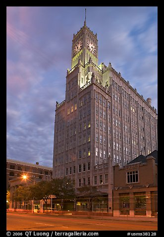 Art Deco building with clock tower at dusk. Jackson, Mississippi, USA