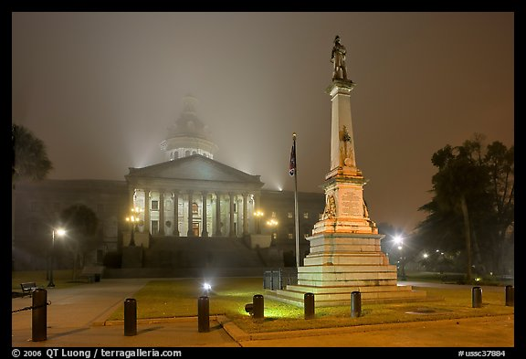 Monument to Confederate soldiers and state capitol at night. Columbia, South Carolina, USA