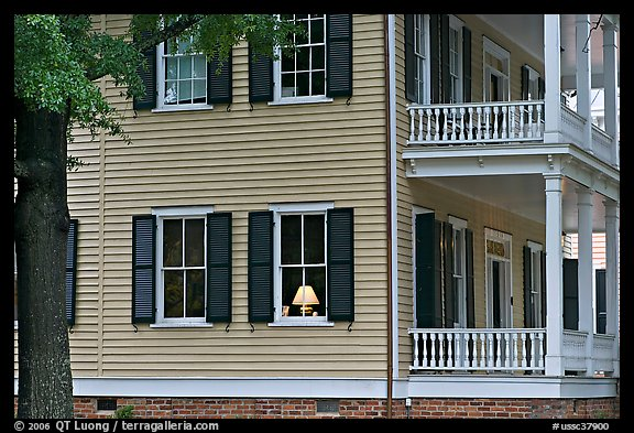 House with lamp inside window. Columbia, South Carolina, USA