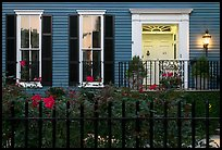 House facade at dusk with roses in front yard. Charleston, South Carolina, USA