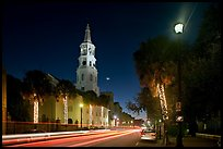 St Michael Episcopal Church and street with traffic at night. Charleston, South Carolina, USA