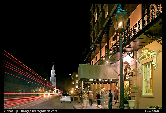 Street, church, and Mills house hotel with many guests at night. Charleston, South Carolina, USA (color)