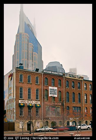 Row of brick buildings and Bell South Tower in fog. Nashville, Tennessee, USA (color)