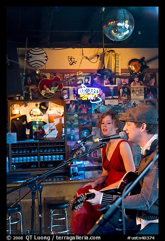 Man and woman singing country music at Tootsie Orchid Lounge. Nashville, Tennessee, USA (color)