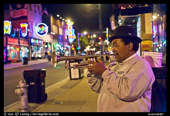 African-American man playing trumpet on Beale Street by night. Memphis, Tennessee, USA (color)