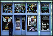 African-American man standing in front of blue storefront on Beal street. Memphis, Tennessee, USA ( color)