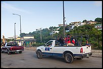 Residents riding in back of pick-up trucks, Cruz Bay. Saint John, US Virgin Islands ( color)