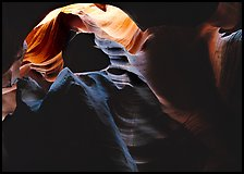 Sandstone walls sculpted by fast moving water, Upper Antelope Canyon. Arizona, USA