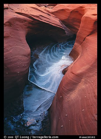 Frozen water and red sandstone, Water Holes Canyon. Arizona, USA