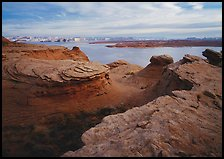 Sandstone swirls and Lake Powell. Arizona, USA (color)