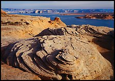 Sandstone Swirls and Lake Powell, Glenn Canyon National Recreation Area, morning. Arizona, USA